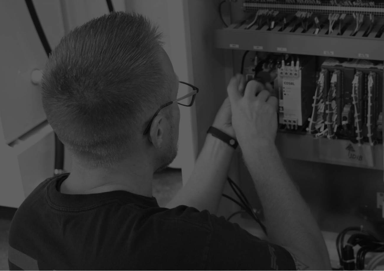 A technician working on a machine