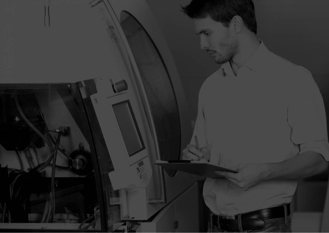 Engineer checking a machine.